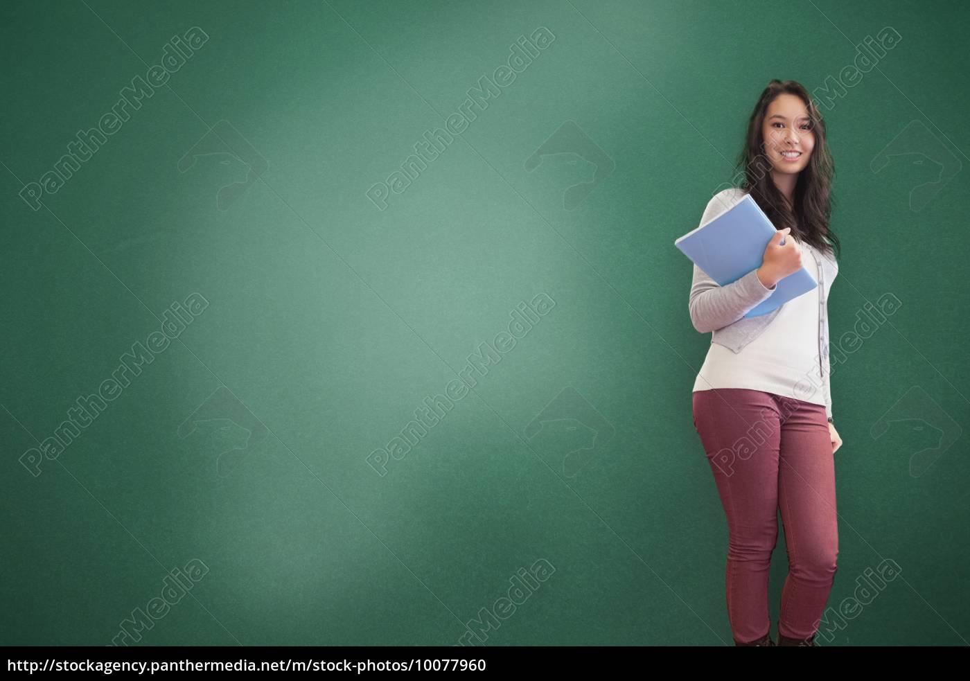 smiling, brunette, holding, notebook, posing - 10077960