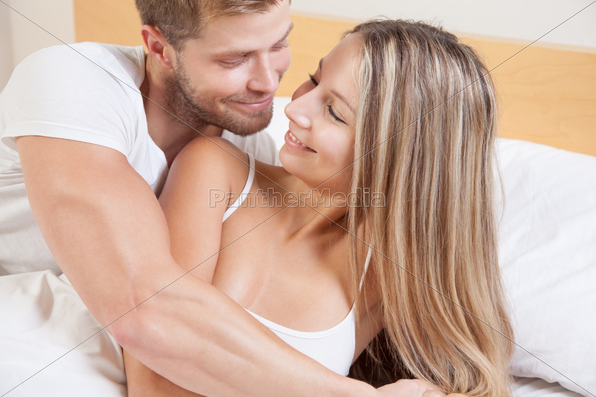 young, happy, couple, in, bed - 10078326