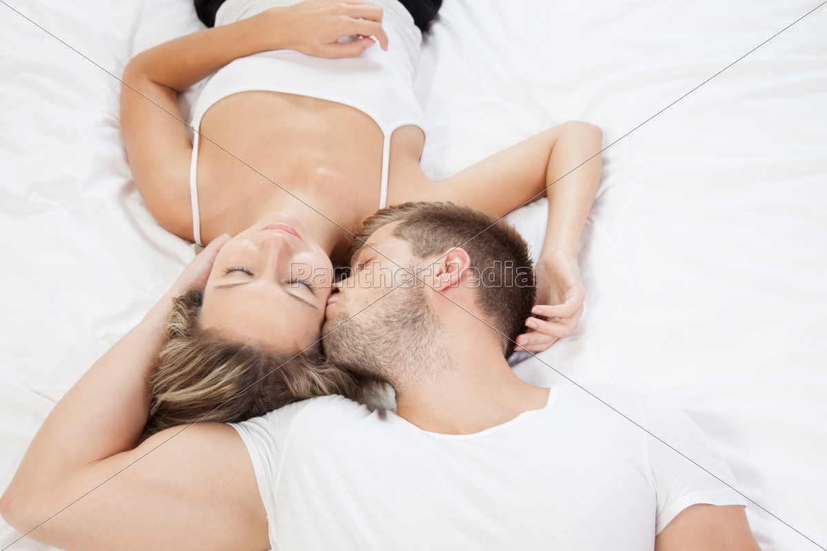 young, romantic, couple, in, bed - 10078306