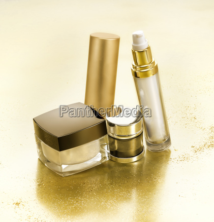 luxury cosmetics in gold environment with