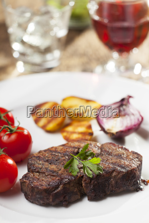 grilled steak with parsley on a