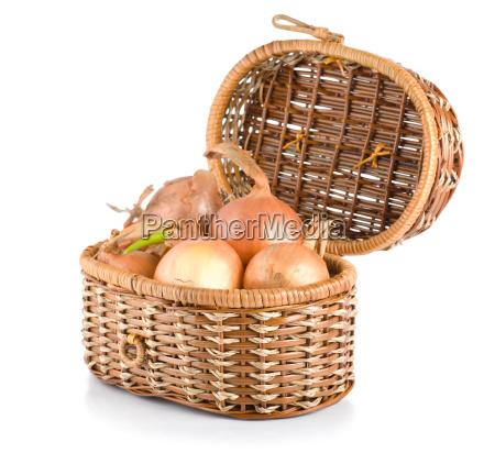 onion in a wooden basket