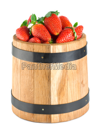 wooden barrel with strawberries