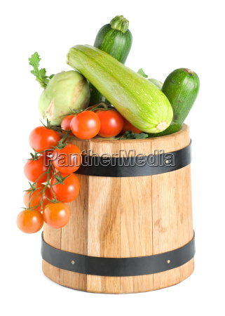 wooden barrel with vegetables isolated