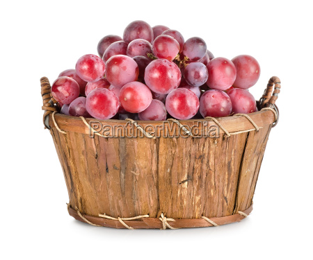 dark blue grapes in a wooden