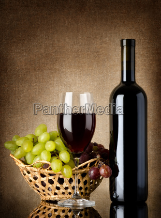wine and grapes on a old