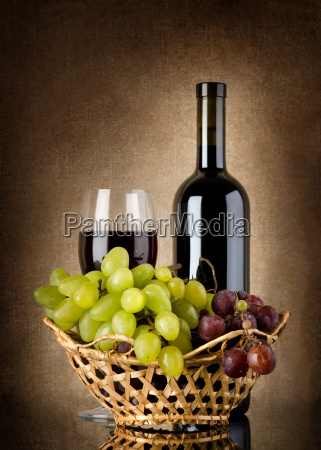 wine and grapes in basket