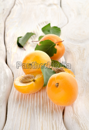 apricots and leaves on a table