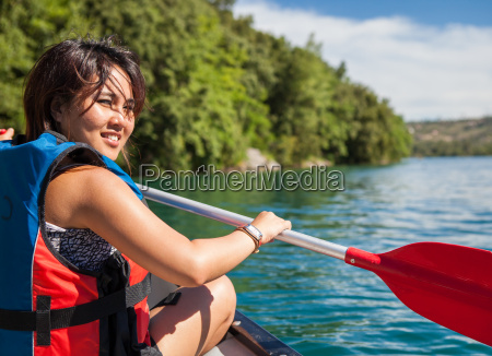 pretty young woman on a canoe