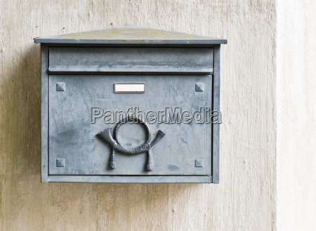 old mailbox on a building wall