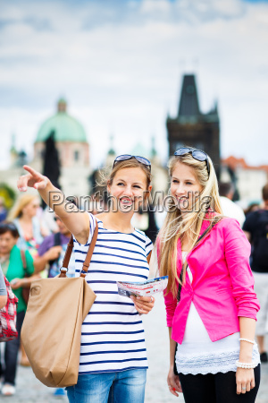 two, female, tourists, walking, along, the - 10147275