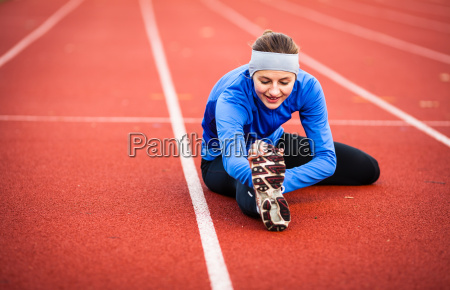young, woman, stretching, before, her, run. - 10147213