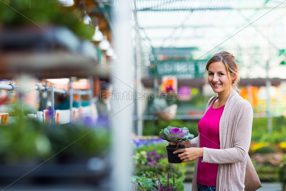 young, woman, buying, flowers, at, a - 10148057