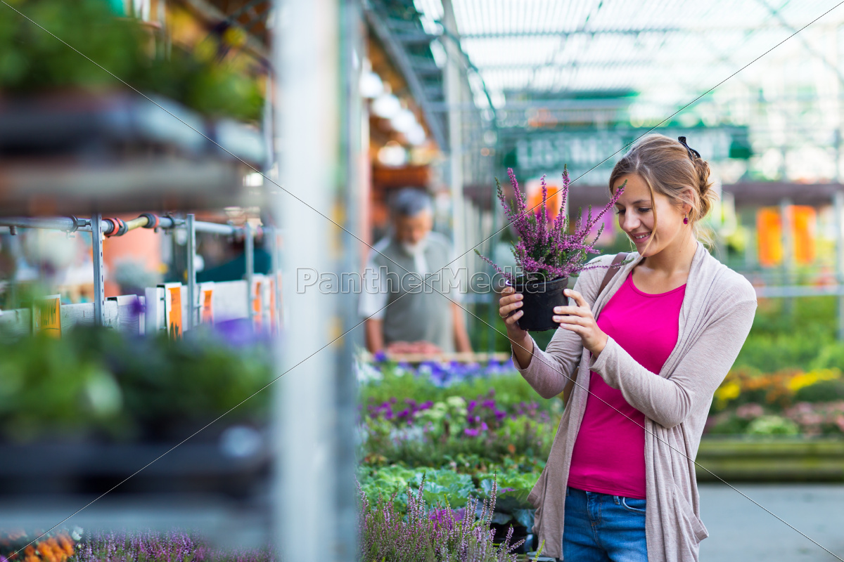 young, woman, buying, flowers, at, a - 10148063