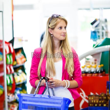 beautiful, young, woman, shopping, in, a - 10150085