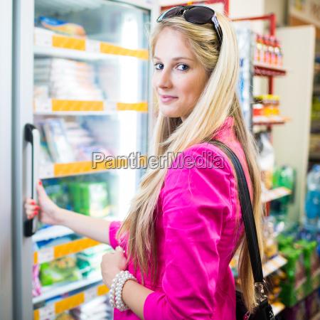 beautiful, young, woman, shopping, in, a - 10150137