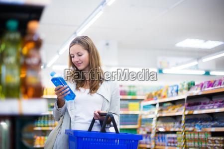 beautiful, young, woman, shopping, in, a - 10150167