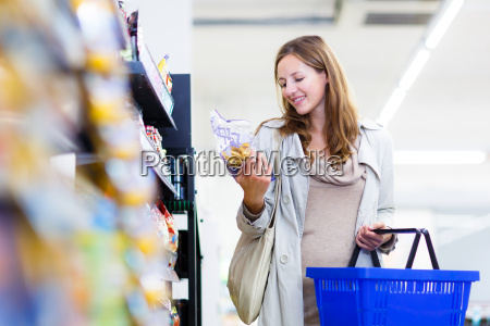 beautiful, young, woman, shopping, in, a - 10150171