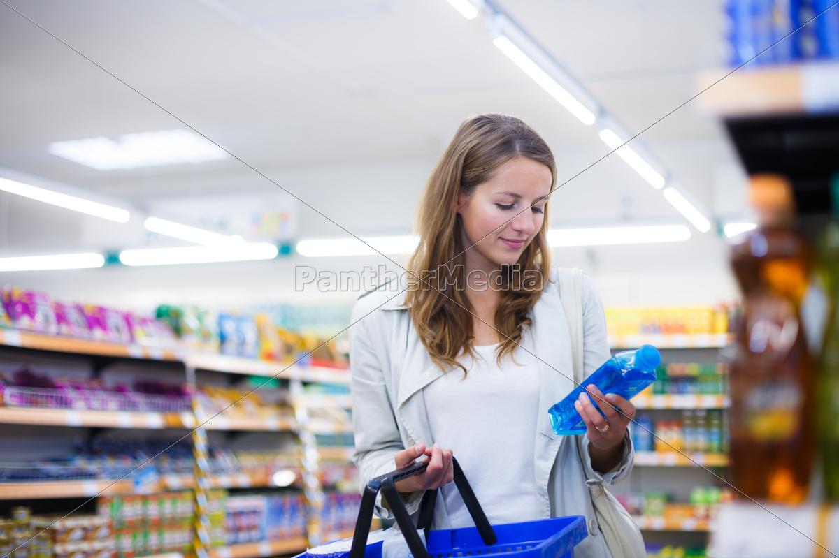 beautiful, young, woman, shopping, in, a - 10150175