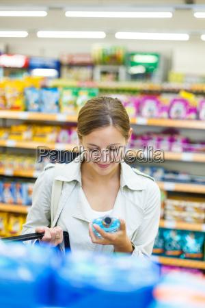 beautiful, young, woman, shopping, in, a - 10150181