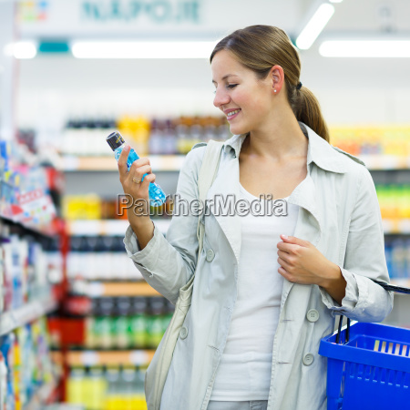 beautiful, young, woman, shopping, in, a - 10150185
