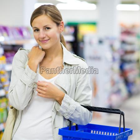 beautiful, young, woman, shopping, in, a - 10150191