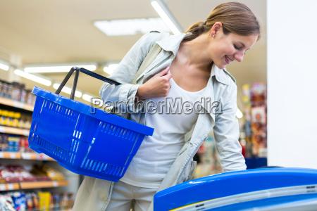 beautiful, young, woman, shopping, in, a - 10150211