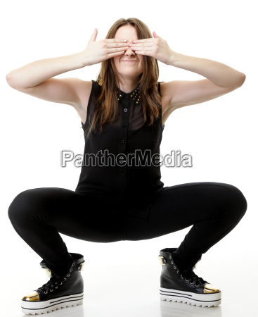 scaredyoung woman covering her eyes