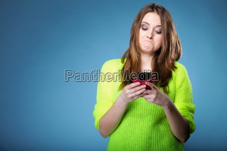 funny girl with mobile phone reads
