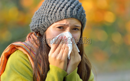 girl with allergy or cold using
