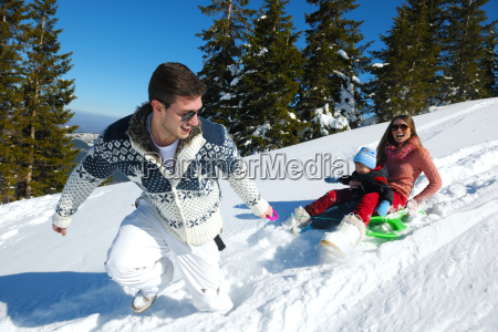 family, having, fun, on, fresh, snow - 10168603