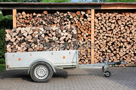 trailer and shed with firewood firewood