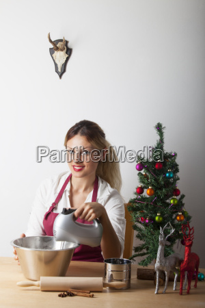 woman baking with christmas tree