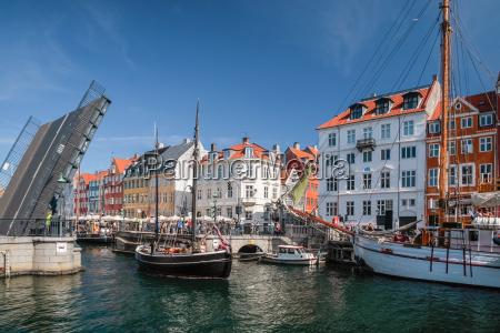 drawbridge with sailboat in nyhavn in