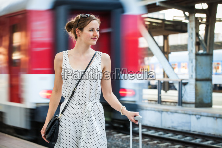 pretty, young, woman, at, a, train - 10198781