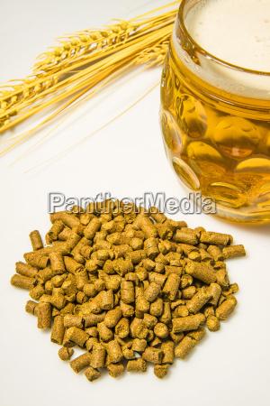 hop pellets with beer glass