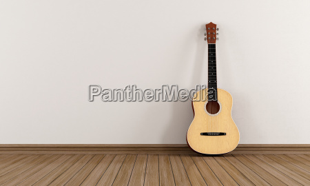acoustic, guitar, in, a, empty, room - 10202239