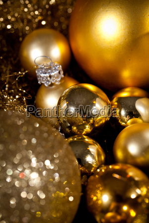 festive golden christmas decoration in candlelight