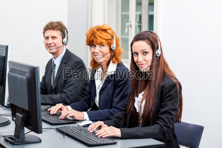call center employee with headphones at