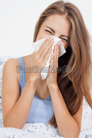 young woman sick in bed cold