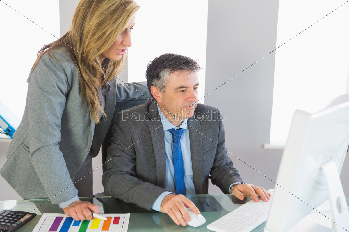two, businesspeople, looking, at, something, on - 10209753