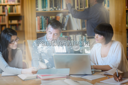 focused mature students working together on