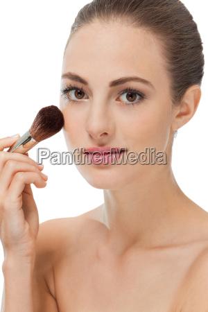 young woman is wearing makeup makeup