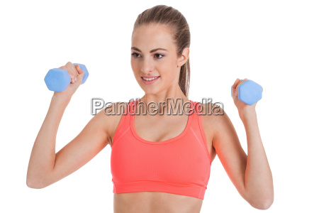 young attractive sporty woman with dumbbells