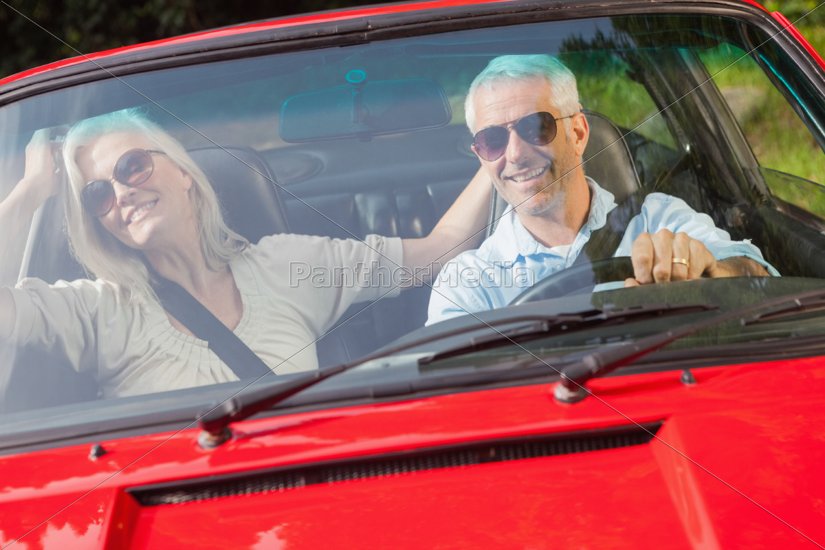 happy, mature, couple, in, red, cabriolet - 10212631