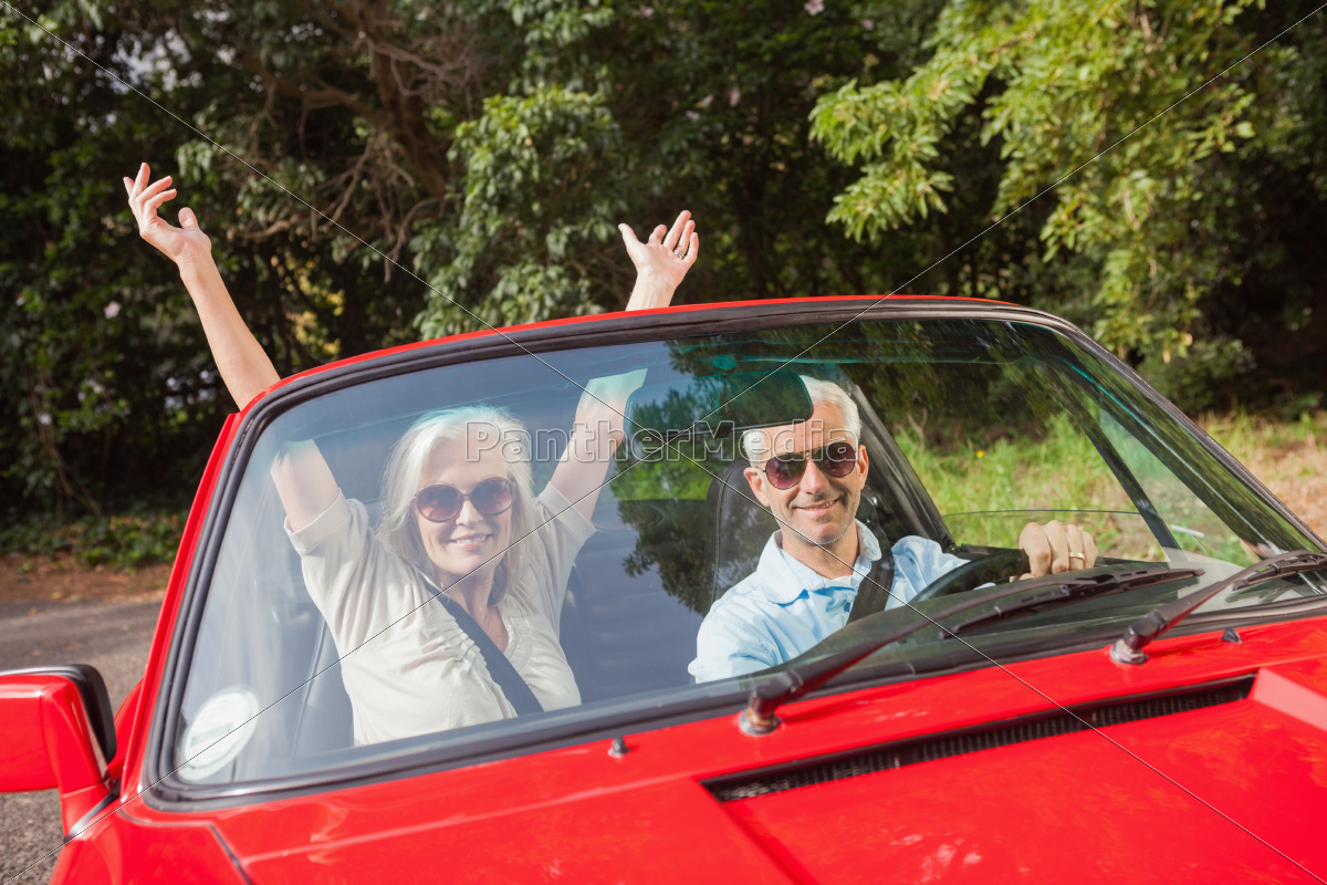 mature, couple, in, red, cabriolet, cheering - 10212639