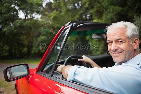 smiling, handsome, man, driving, red, cabriolet - 10212587