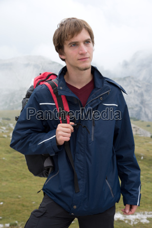 portrait young hiker in mountains