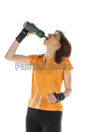 sportswoman drinking from her water bottle