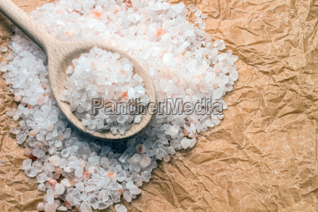 wooden spoon with coarse salt on